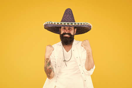 In love with mexico. hipster looks festive in sombrero. celebrating fiesta. happy man wear poncho. having fun on mexican party. sombrero party man. man in mexican sombrero hat. Celebrate traditions