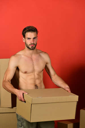 Delivery and moving in concept: man with naked torso Stock fotó