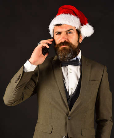 Manager with beard talks on cellphone. Businessman with serious face