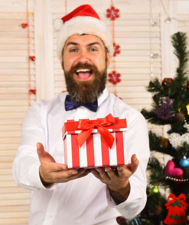 Man with beard holds striped present box. Stock fotó