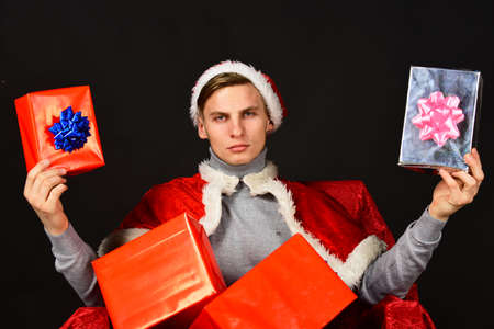 Man with Christmas presents. Holiday presents concept