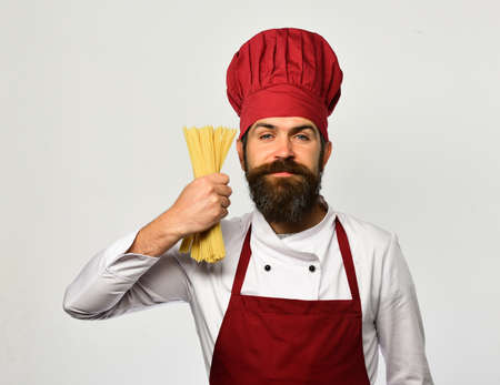 Man with beard on white background. Cook with smiling face Standard-Bild