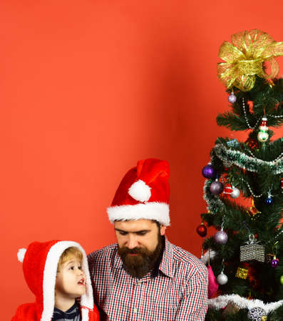 Dad with beard and kid talk near Christmas tree. Stock fotó
