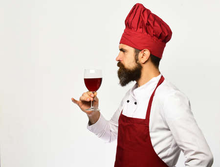 Man with beard holds glass of wine on white background Stock fotó