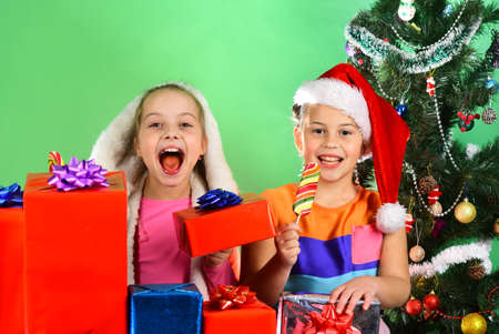 Girls celebrate Christmas, copy space. Children with excited faces Stock fotó