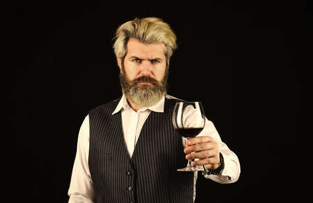 Wine bar or winery. drink degustation. Bearded businessman in elegant suit with glass of wine. Sommelier tastes expensive drink. Elegant waiter drink red wine. working in wine cellar