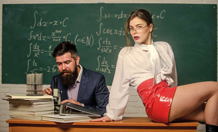Experimenting with feelings. Attractive teacher latex skirt. Cheeky teacher. Impudent student. Flirting colleague. Lustful tutor. Girl sexy buttocks sit table. Everyone dreaming about such teacher