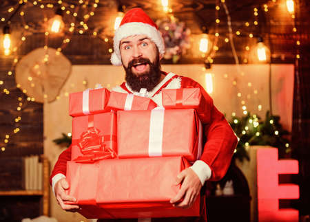 May your home be filled with all joys of season. New year celebration. Santa claus hold many gifts. Celebrate with joy. Celebrate winter holidays. Man bearded santa celebrate christmas with presents Archivio Fotografico