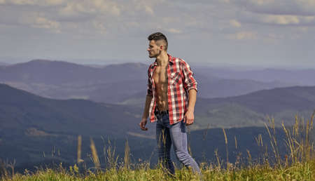 A decision for nature. travelling adventure. hipster fashion. countryside concept. farmer on rancho. man on mountain. camping and hiking. sexy macho man in checkered shirt. cowboy in hat outdoor 版權商用圖片