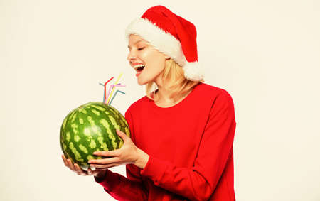 Ways to detox after christmas day. Girl wear santa hat drink watermelon cocktail straw white background. How detox after christmas. Winter detox concept. Woman enjoy detox drink. Health care concept. Stock fotó
