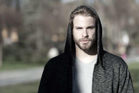 man in hood sunny outdoor, sport fashion