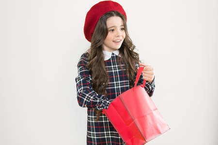 Little french lady adore shopping. Birthday girl. Favorite brands hottest trends. Girl with shopping bag. Explore fashion industry. Shopping and purchase. Black friday. Sale discount. Shopping day
