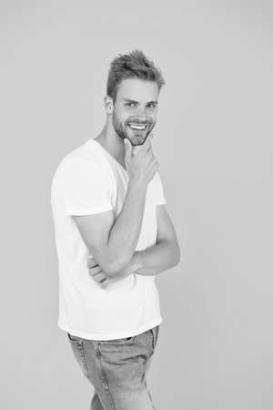 Face expression. Emotional means alive. Psychology concept. Emotional handsome guy. Sexy handsome confident young man standing in white shirt. Summer and spring collection. Emotional intellect Reklamní fotografie