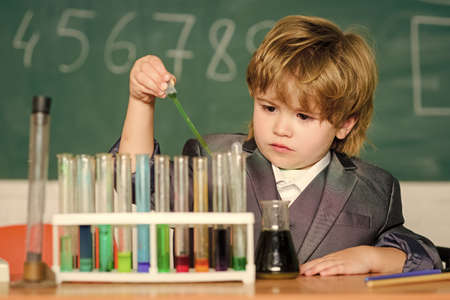 Boy test tubes liquids chemistry. Chemical analysis. Knowledge day. Kid study chemistry. Biotechnology and pharmacy. Genius pupil. Education concept. Experimenting with chemistry. Talented scientist Stock fotó