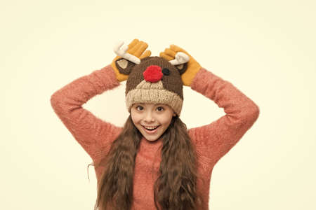 Christmas carnival. Fun and joy. Cheerful kid. Playful cutie. Adorable baby wear cute winter knitted deer hat. Cute reindeer with red nose. Cute accessories. Girl wear winter theme accessory Stock Photo