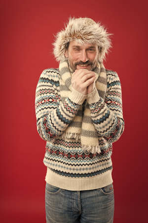 Its cold, warm yourself. Senior man shiver in cold weather wear. Mature man feel cold red background. Chilly winter season. Frosty and cold. Coldness. Warm fashion wear and accessory