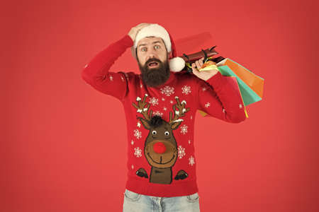 Leaving showroom. shopping expectations. shocked bearded man new year present. gift packages from santa. xmas winter style. online christmas shopping for men. men are goal oriented. Male Shopper