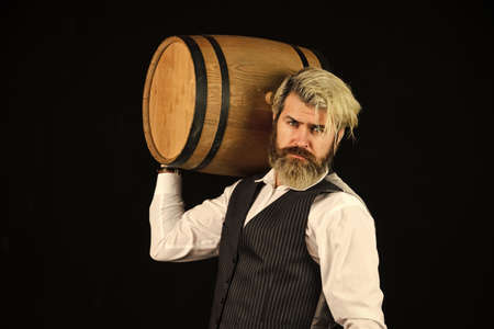 This is perfect wine. wine in barrel. bearded man explore taste of wine in restaurant. Checking color and sediments. Wine tasting. Male skilled sommelier estimates alcoholic drink