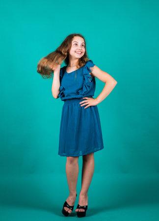 pretty teen girl with long hair in dress, fashion