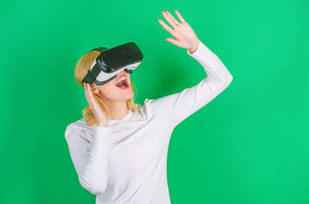 Woman using VR device. A person in virtual glasses flies in room space. Woman excited using 3d goggles. Augmented reality, technology, business and people concept -businessman in virtual glasses.