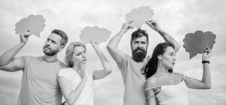Couple in love relations. Romantic relations. Difference between men and women. Thoughts of different sex. Bearded hipster and girl with speech bubbles copy space. Diversity concept. Relations issues