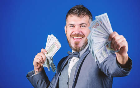 Starting his own business. Rich businessman with us dollars banknotes. Bearded man holding cash money. Making money with his own business. Currency broker with bundle of money. Business startup loan
