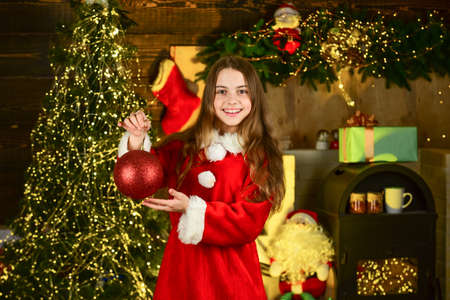 Decorations rental services. Happy childhood. Little girl celebrate christmas. Holiday accessories rental. Winter holidays concept. Celebrate new year near christmas tree. arnival costume rental