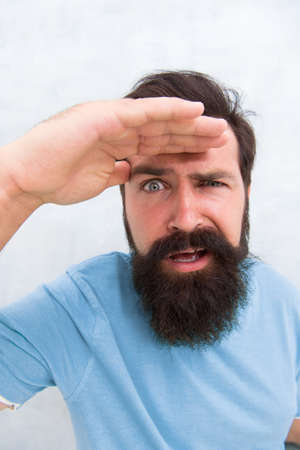 Suspicious look. Man bearded hipster stylish beard grey background. Perceptions of male beauty. Stylish beard and mustache care. Strict face. Beard fashion barber. Handsome guy. Masculinity concept