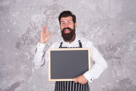 best choice. advertisement and food. cooking by recipe. Master class from cook man. best offer for dinner. chef baker menu. cheerful hospitable restaurant waiter with chalkboard, copy space