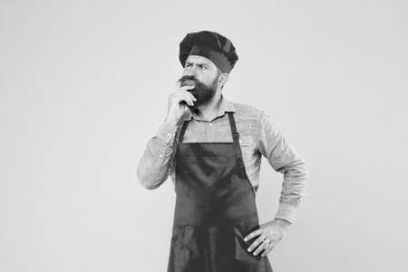 time for lunch. thinking bearded chef. male cook in hat and apron. professional man cooking. restaurant cuisine and culinary. catering business company. welcome to our cafe. Flavorful occasions