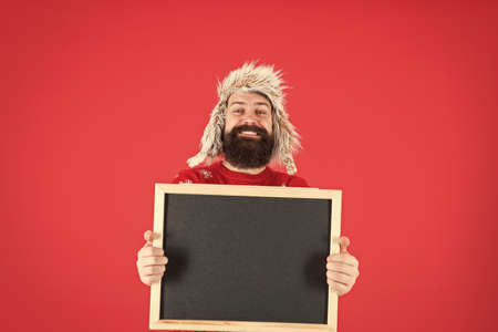 Learn barbering, become barber. Happy barber hold blackboard. Bearded man advertising barber school. Barber shop. Barbershop, copy space