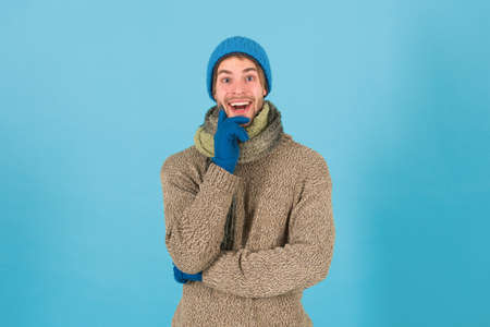When weather turns chilly. Happy man in winter style blue background. Handsome guy in casual comfy style. Winter fashion and accessories. Keep warm in style. Maintaining your style is easy