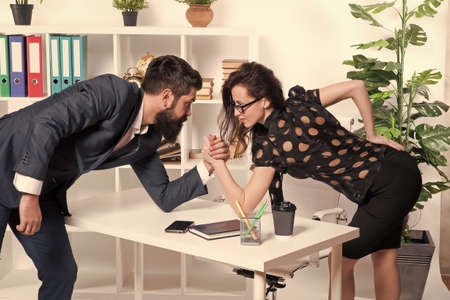 Dont give up. Business competition. Bearded man and woman compete in business. Professional couple face competition. Contest or rivalry. Competition advantage. Competition environment