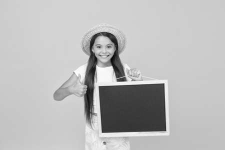 teen girl summer fashion. travel to warm country. summer shopping sales. happy small girl hold board. kid show thumb up. advertising and marketing. kid camp schedule for summer activity. copy space