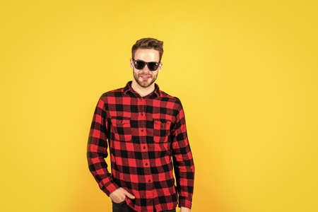handsome casual man standing with beard and bristle. cheerful and stylish. handsome man in sunglasses. indoor portrait of european businessman. confident and calm. copy space. Funky style beauty