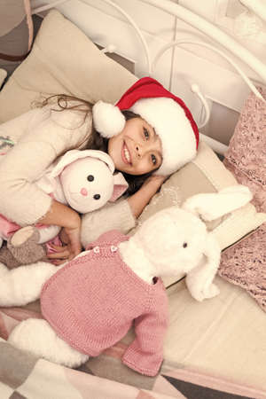 New year new smile. Santa baby go to sleep feeling happy. Little girl with happy smile relax in bed. Smile because you look pretty. Close each day with smile. Good night. Sweet dreams Banque d'images