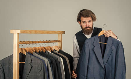 Bearded man collector vintage clothes showing formal suit, retro stock concept
