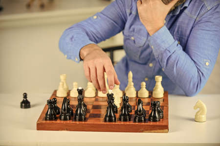 Playing chess. Intellectual hobby. Figures on wooden chess board. Thinking about next step. Tactics is knowing what to do. Development logics. Learning play chess. Chess lesson. Strategy concept