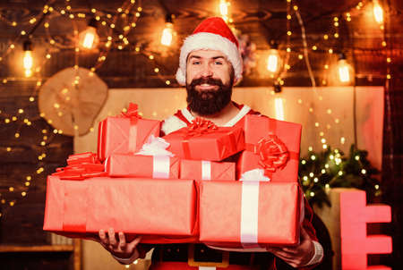 Man bearded santa celebrate christmas with presents. May your home be filled with all joys of season. New year celebration. Santa claus hold many gifts. Celebrate with joy. Celebrate winter holidays