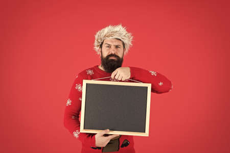 Invitation concept. Winter announcement. Winter event. Bearded hipster man blank blackboard copy space. Santa Claus advertisement. Chalkboard for information. Event promotion. Christmas event