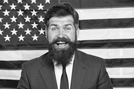 July 4. American citizen usa flag. American citizen. Elections in USA. National holidays. Celebration of victory. Bearded hipster man being patriotic for usa. Proud of motherland. American reform