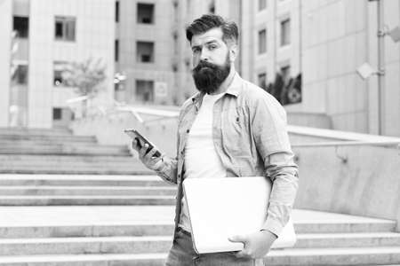 Phone you always desired. Bearded man use phone outdoors. Mobile phone messaging. SMS message. Cell phone. Smartphone. Portable telephone. New technology. Modern life. Making communication easier