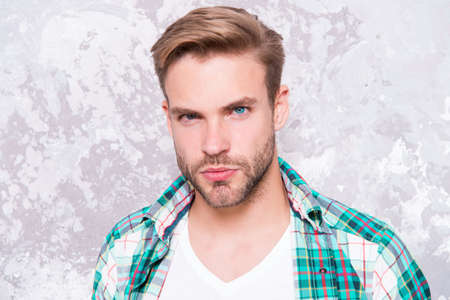 macho man grunge background. male fashion spring collection. charismatic student checkered shirt. unshaven man care his look. barbershop concept. mens sensuality portrait. guy casual style
