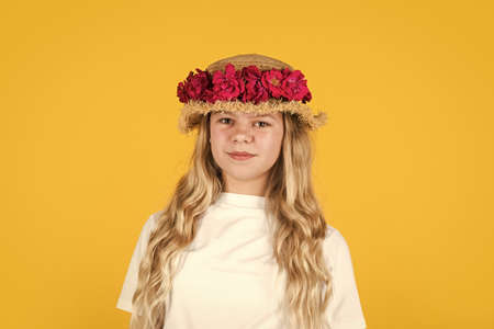 Live brightly. Portrait of small kid with flowers. love and beauty. stunning girl with flowers of roses in hat. happy child in straw hat. Hairstyle of nature. mothers day. happy womens day