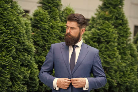 Successful and motivated. Business life. Man businessman classic style urban park. Business man bearded wear perfect fashionable suit. Businessman well groomed hairstyle beard. Business concept
