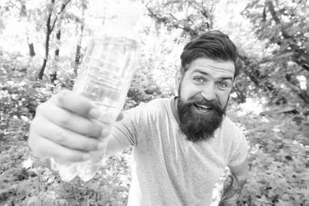 Fix It All With H2O. brutal caucasian hipster with moustache. Bearded man drink water. ready for camping. male happy tourist feel thirsty. sport and fitness clothes. Confident and handsome brutal man