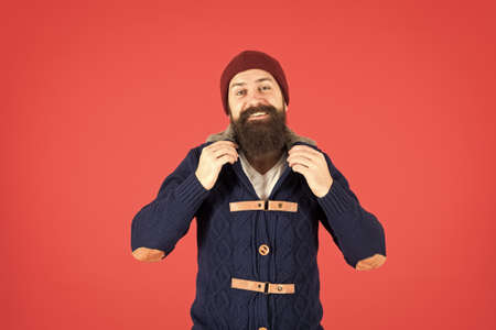Male fashion concept. Man bearded hipster stylish fashionable jumper and hat. Hipster with long beard. Hipster lifestyle. Stylish outfit hat accessory. Fashion trend. Casual clothes for winter season