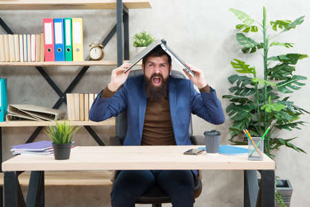 Companys collapse. Exhausted manager hold laptop on head. Poor management. Collapse from burnout and exhaustion. Crisis and depression. Business failure. Experiencing financial distress