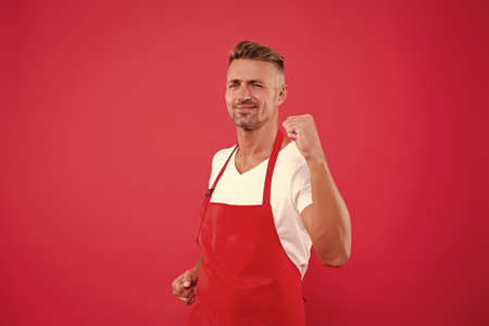 yes, we did it. cheerful mature waiter celebrate success. waiter in a restaurant. he will take the order. best waiter service. handsome waiter in red apron. Successful small business owner