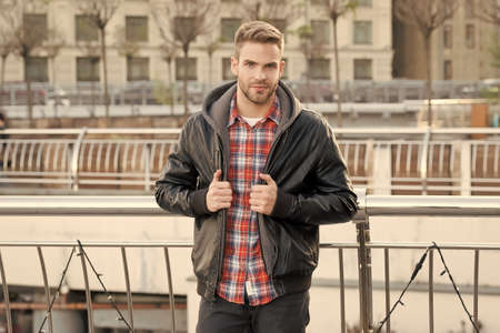 Male fashion. Waiting for you. Just relaxing here. Man wearing leather jacket. Street style. Portrait guy outdoors. Menswear concept. Fashion outfit. Urban man. Personal style. Handsome student